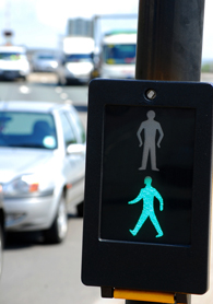 Close Up Of Pedestrian Crossing Sign On Busy Road