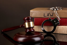 Gavel Handcuffs And Books On Law