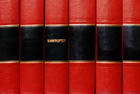 Close Up Of Several Volumes Of Books On Bankruptcy