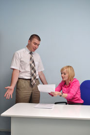 The Girl Shows A Piece Of Paper And Arguing With A Colleague