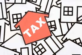 A Red Home Tax Sign Real Estate Concept